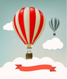 Retro background with colorful air balloons and clouds. Royalty Free Stock Photos