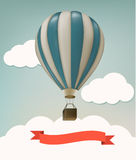 Retro background with colorful air balloons and clouds. Stock Image