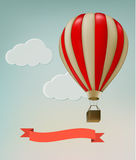 Retro background with colorful air balloons and clouds. Stock Photos