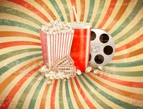 Retro background with Popcorn and a drink. Stock Photos