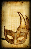 Retro background with venetian mask. Retro postcard with venetian golden carnaval mask Royalty Free Stock Photos