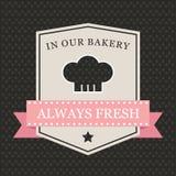 Retro bagerietikett med kockhatten Royaltyfria Foton