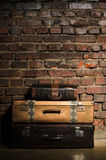 Retro bags on brick wall background Royalty Free Stock Images