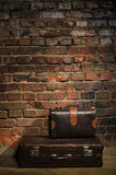 Retro bags on brick wall background Stock Photo