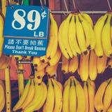 Retro banane del mercato di Chinatown Fotografia Stock