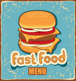 Retro banner with cheeseburger. On blue background Stock Photos