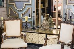 Retro baroque room. Antique design room with clock and beautiful armchairs. Antique furniture royalty free stock photo