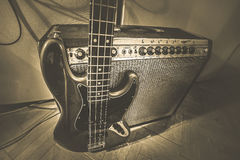 Retro bass guitar with amplifier Royalty Free Stock Photo