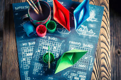 Retro battleship paper game with coloured ships Stock Photography