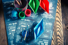 Retro battleship paper game with red and blue ships Royalty Free Stock Photos