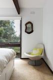 Retro beach house bedroom chair in corner Stock Image