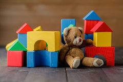 Retro Bear toy alone on wooden floor Royalty Free Stock Photography
