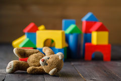 Retro Bear toy alone on wooden floor Royalty Free Stock Image