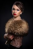 Retro. Beautiful, attractive woman wearing fur Royalty Free Stock Photography