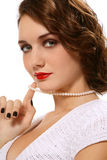 Retro beauty. Portrait of beautiful stylish young woman with retro makeup and pearl necklace Stock Photography