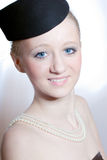 Retro Beauty. Beautiful blond young woman with retro hat and pearl necklace stock images