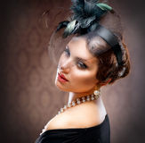 Retro Beauty Portrait. Vintage Styled. Beautiful Young Woman stock image