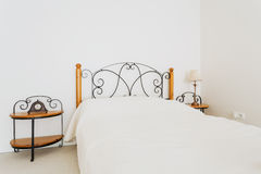 Retro bed with designed headrest Stock Photography