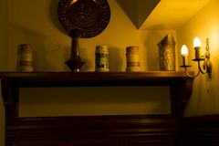 Retro beer mugs expose in a retro restaurant. Photo with ambient light Stock Photos