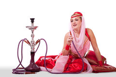Retro belly dancer posing with hookah Royalty Free Stock Photo