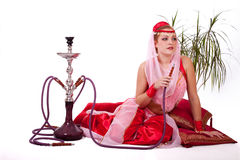 Retro bellydancer posing with hookah Stock Photo