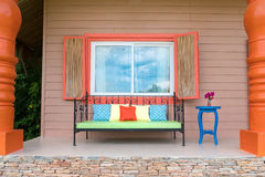 Retro bench outside small vacation house, colorful decoration.  Royalty Free Stock Photography