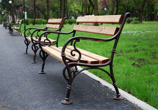 Retro benches in park Royalty Free Stock Photo