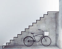 Retro bicycle with basket in front of the interior concrete wall, Stock Photography