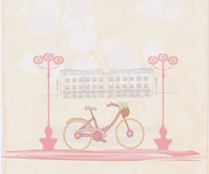 Retro Bicycle with Flowers over City - card Royalty Free Stock Photos