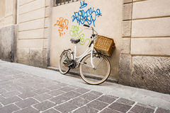 Retro bicycle and graffiti. Stock Photos