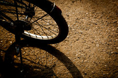 Retro bicycle on the ground Royalty Free Stock Photos