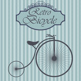 Retro bicycle on hipster background. Vintage sign design. Old fashion theme label.  Royalty Free Stock Image