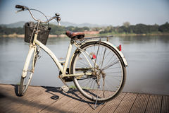 Retro bicycle. Near lake during sunset.Vintage bike near the lake in the evening, warm sunset view stock photos