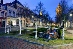 Retro bicycle, the old church and canal in Delft, The Netherland Royalty Free Stock Images