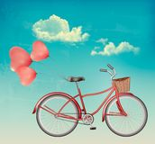 Retro bicycle with red heart shaped balloons. Stock Images
