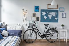 Retro bicycle in teen bedroom Stock Photos