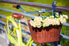 Retro bicycle with wicker basket and flowers Royalty Free Stock Photo