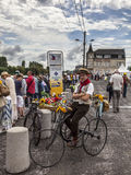 Retro Bicyclist. Saint Quentin,France,July 5th, 2012: Image of a retro sytle bicyclist in the streets of St.Quentin just before arrival of the cyclists during Royalty Free Stock Photo