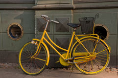 Retro bike. Old lady retro bike painted with yellow color Stock Images