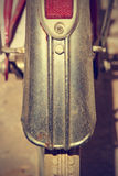 Retro bike fender detail. Vintage style. Detail retro bicycle fender. It looks part of the brake and wheel. Vintage style. Vertical image Royalty Free Stock Photos