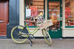 Retro bike in front of a shop, Gouda, Netherlands Royalty Free Stock Images