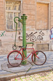 Retro bike near old water-pump in Prague Stock Images