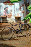 Retro bike with STREET ART Painting on the the wall two cute lit Royalty Free Stock Photo