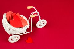 Retro bike with white wicker basket full of red paper hearts. Cute trinket retro bike with white wicker basket full of red paper hearts stock photography