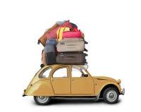 Retro bil med bagage royaltyfria foton