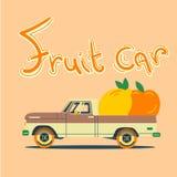 Retro bil med stora frukter Arkivbild