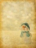 Retro bild med lyckliga snögubbear. Arkivfoton