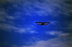 Retro-biplane aircraft, against the blue sky Stock Images