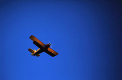Retro-biplane aircraft, against the blue sky Royalty Free Stock Image