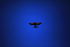 Retro-biplane aircraft, against the blue sky Royalty Free Stock Photo